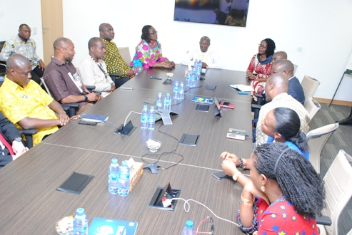 7. MINISTER INTERACTS WITH MANAGEMENT AFTER A TOUR OF THE FACILITY