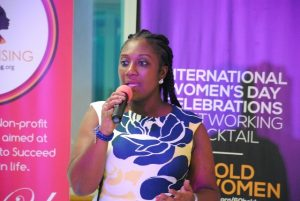 Mrs Georgina A. Fiagbenu addressing a group of women enttreprenurs as part of activities to mark World Women's Day