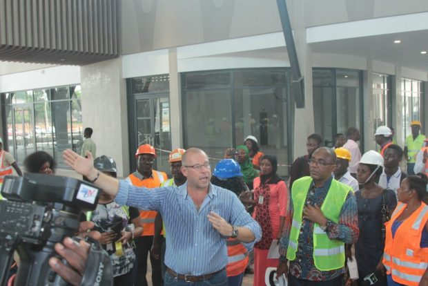Mr. Gerber explains a point about the architecture to journalists as Chairman Kofi Sekyere looks on during the facility tour of the Kumasi Press Corps