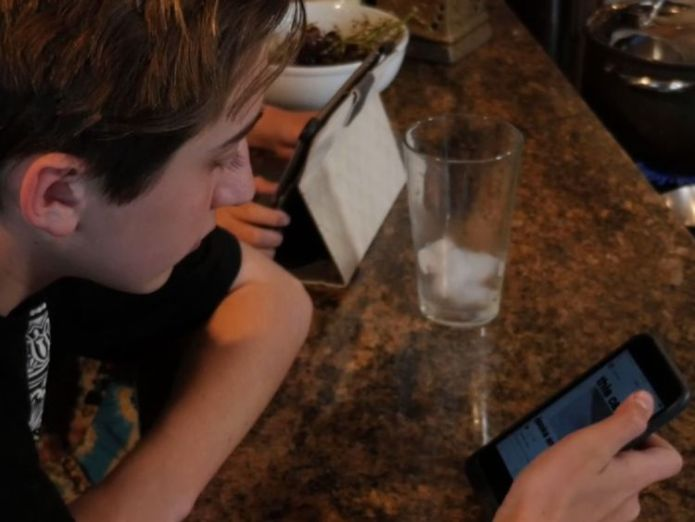 Michael Koch, 14, says he is not a technology addict - but he still has trouble putting his phone down