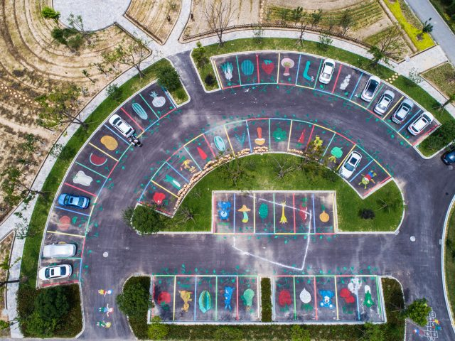 Aerial photo taken on June 18, 2017 shows a parking lot at a vegetable-themed park under construction in Yanglou Village of Huzhou City, east China's Zhejiang Province. In response to the program of building beautiful countryside, the village, which is located by the Taihu Lake, has invested over 30 million yuan (4.4 million U.S. dollars) to improve its environment. (Xinhua/Xu Yu)