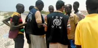 IOM staff assist Somali, Ethiopian migrants who were forced into the sea by smugglers. Photo: UN Migration Agency (IOM) 2017