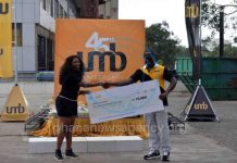 Mr John Awuah (R) presenting the check to Ms Yvonne Botchey