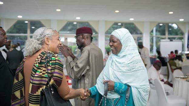 U.S. Agency for International Development – Ghana Mission Director Sharon Cromer, in a warm hand-shake with the President of the Zakat Fund, Mrs. Azara Abubakari-Harou,.
