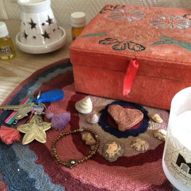 Oil scent diffuser, key chain, hamsa bracelet, shells from Essaouira and a candle from the Royal Mansour.