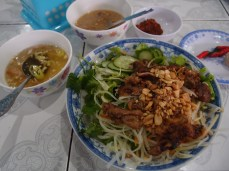Grilled pork salad with noodles and fresh herbs in Hue, Vietnam