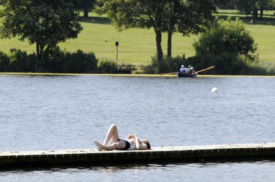Not for use in UK newspapers and UK internet until 30/07/2012 Mandatory Credit: Photo by London News Pictures/REX/Shutterstock (1805166b) People enjoy a sunny day at the boating lake in Danson Park, Bexley, Britain Hot weather, Bexley, Britain - 26 Jul 2012