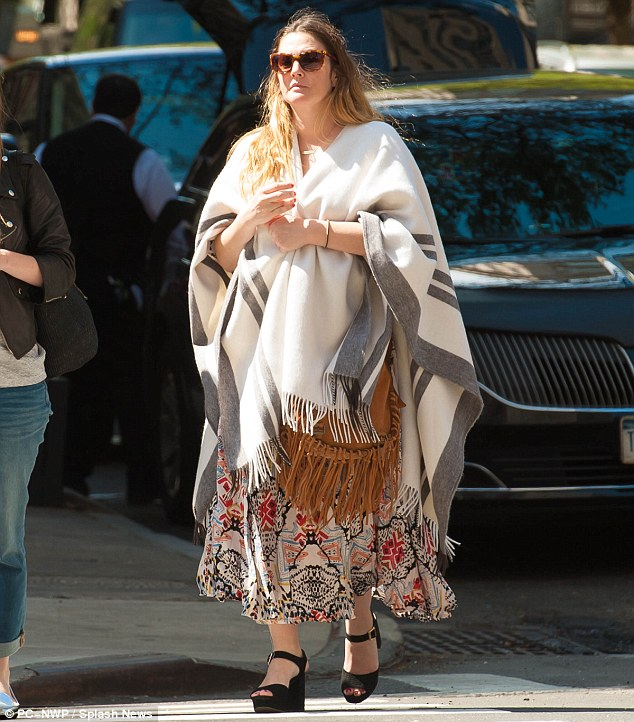 Enjoying her day: Drew Barrymore, 41, appeared to be in good spirits as she strolled through the streets of NYC on Saturday