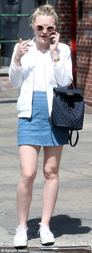 Casual look: The Benefactor actress tucked in a solid colour T-shirt into a high waist mini skirt