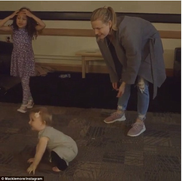 Falling on her bottom: The Instagram clip begins with wife Tricia picking daughter Sloane up off the floor, to see if she will walk on her own.After helping her secure her balance, the tiny tot wriggles free and immediately falls to the floor