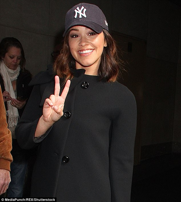 Peace out: The star wore a NY hat and flashed a peace sign