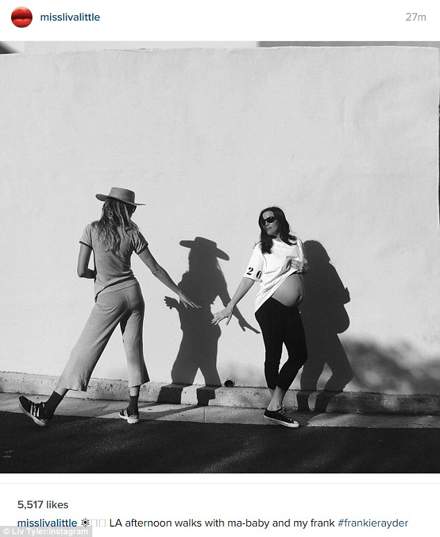 Bare-belly: After revealing her baby news the blue-eyed beauty posted this snapshot to her Instagram with the caption: 'LA afternoon walks with ma-baby and my frank'