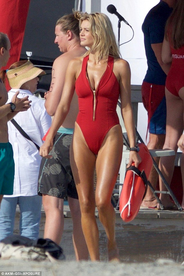 Another day at work: On Tuesday, Kelly Rohrbach showed off her fit form as she filmed scenes for Baywatch in Tybee, Georgia