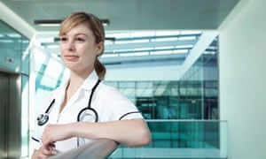 Portrait of nurse leaning on railing