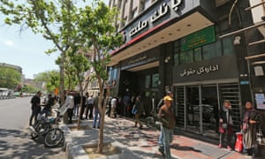 Iranians queue outside a bank in the Islamic republic's capital Tehran, last week