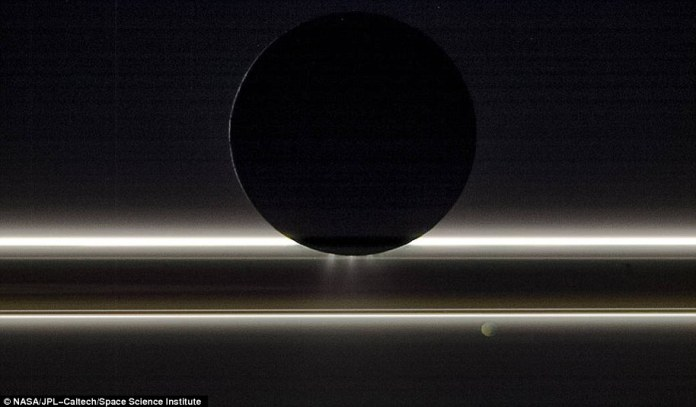 Cassini didn't just study Saturn - it also captured incredible views of its many moons. In the image above, Saturn's moon Enceladus can be seen drifting before the rings and the tiny moon Pandora. It was captured on Nov. 1, 2009, with the entire scene is backlit by the Sun
