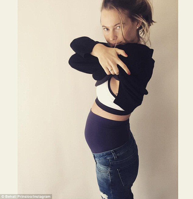 'First pair of maternity jeans': Behati shared a snap of her tiny baby bump