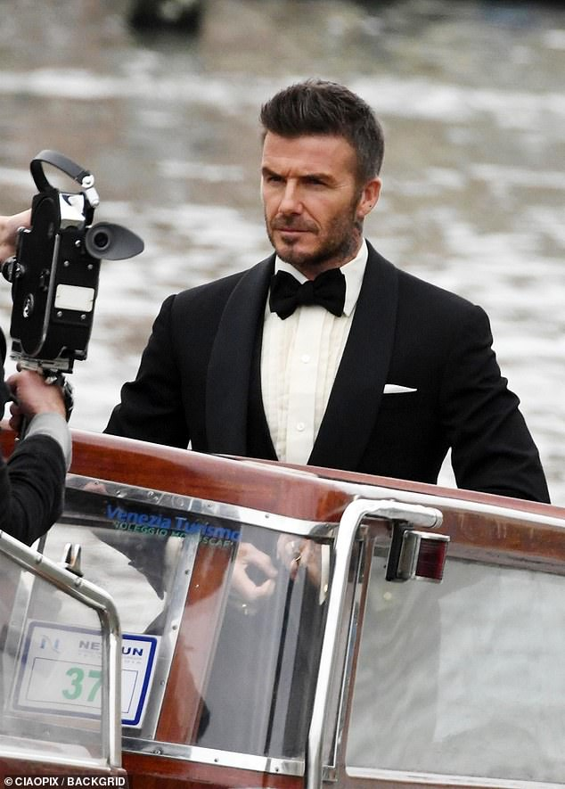 9cd84967e56 Dapper: David Beckham channelled his inner James Bond as he stepped onto a  speed boat