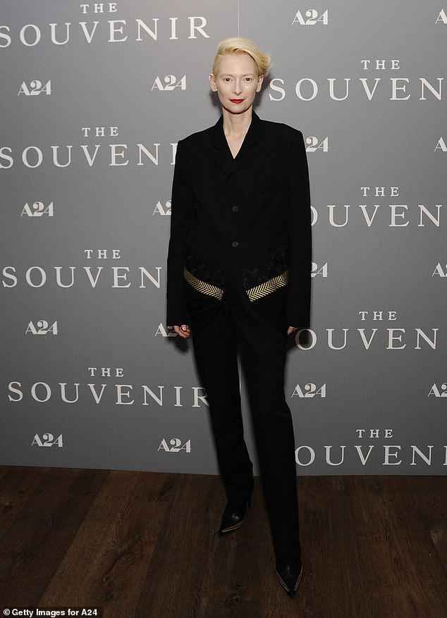 Special screening:Tilda was wearing a black buttoned-up jacked with a gold stripe along the bottom hem, with black pants and black pointed-toe shoes