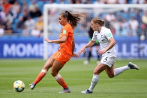 Lieke Martens of the Netherlands passes the ball under pressure from Catherine Bott of New Zealand.