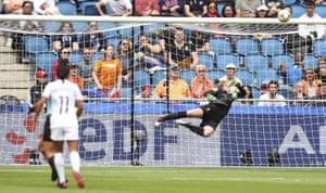 Netherlands goalkeeper Sari Van Veenendaal is beaten by the shot but the ball hits the bar.