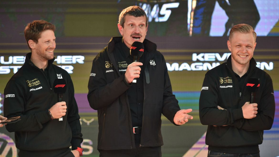 Haas F1 team principal Guenther Steiner (centre) with drivers Romain Grosjean (left) and Kevin Magnussen (right)