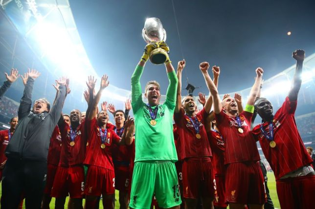 Liverpool goalkeeper Adrian lifts the UEFA Super Cup