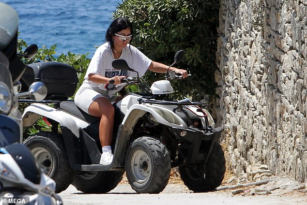 Whoops! Martha Kalifatidis went on a quad biking adventure in Greece on Thursday, but suffered an embarrassing mishap when her front left wheel hit an obstruction in the road