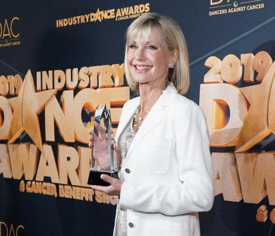 LOS ANGELES, CALIFORNIA - AUGUST 14: Olivia Newton-John attends the 2019 Industry Dance Awards at Avalon Hollywood on August 14, 2019 in Los Angeles, California. (Photo by Rachel Luna/FilmMagic)