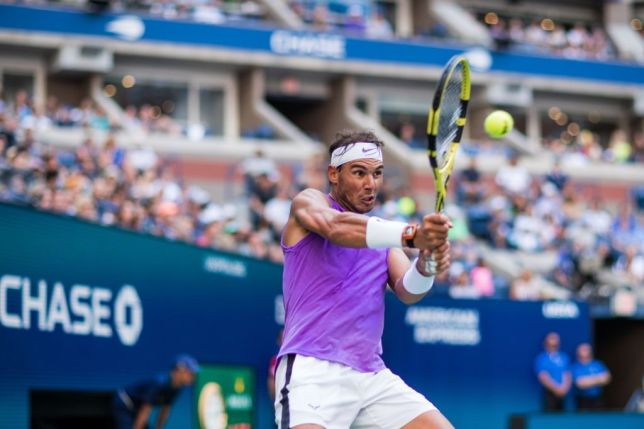 Rafael Nadal hits a backhand against Hyeon Chung