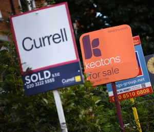 Estate and rental agents' boards are pictured on a residential street in Hackney, east London.
