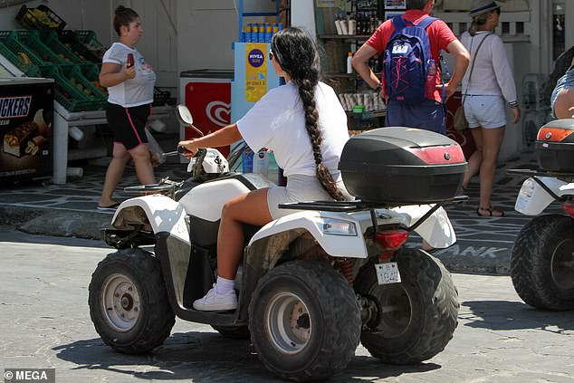 In the driver's seat: For the most part, Martha handled her quad bike like a professional as she weaved her way through traffic and pedestrians