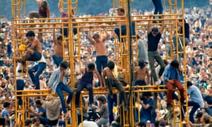Tower of song … festivalgoers on a sound system at Woodstock.