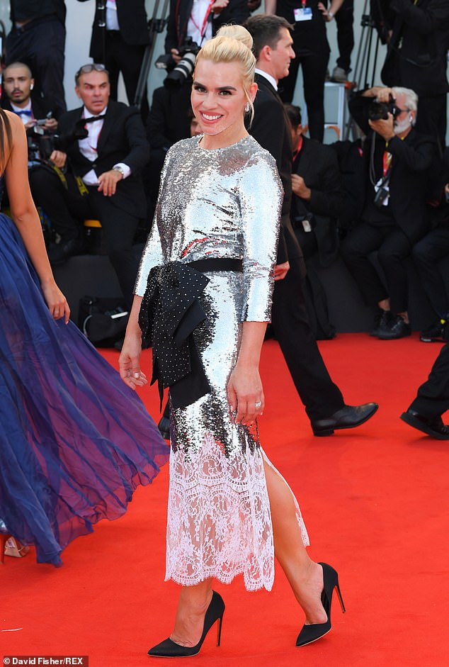 Star quality: The singer-turned-actor wowed in a glitzy sparkling gown which hugged her lithe frame, nipped in at the waist with a black and white polka-dot bow