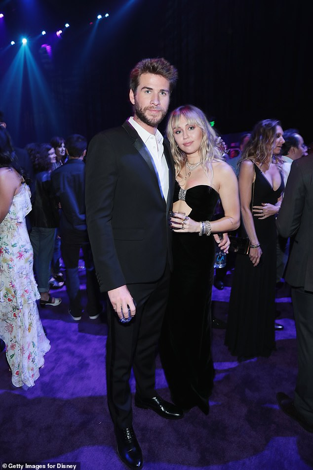 Happier times: According to People, It has been claimed Miley is upset with the 29-year-old actor's decision, as although she's 'doing well', it's 'hard' for her to accept her relationship is over; pictured together April 22 at the premiere of Avengers: Endgame in Los Angeles