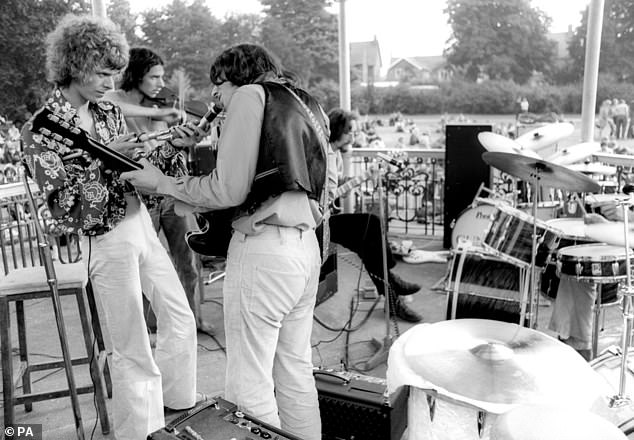 David Bowie, left, is pictured playing with other musicians at the festival. The event in Beckenham, south-east London, was held 50 years ago today to raise money for an arts project run by the future rock star