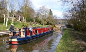 A narrow boat in the Peak District on the Caldon Canal between Stoke-on-Trent and Leek.