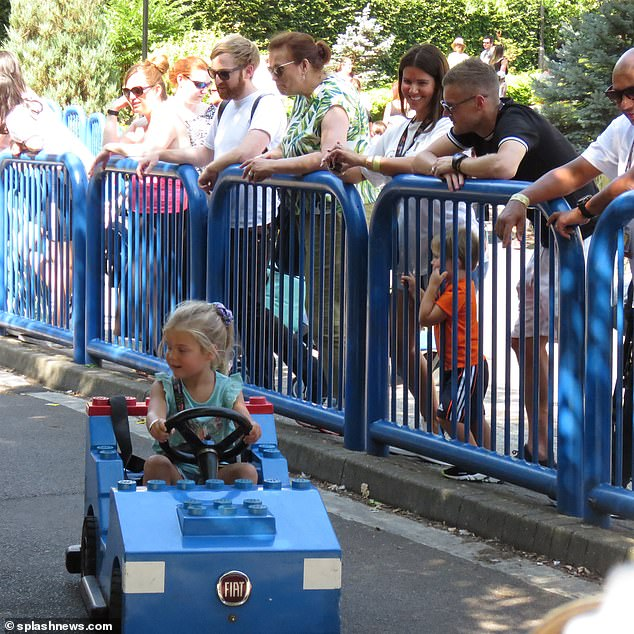 Baby driver:Their children were having the best day as little Sofia was snapped zooming around in a car on a children's race track as her parents watched on