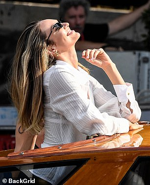 Full of joy: Candice appeared happy and relaxed as she strolled through the Italian city, before making her way onto a water taxi