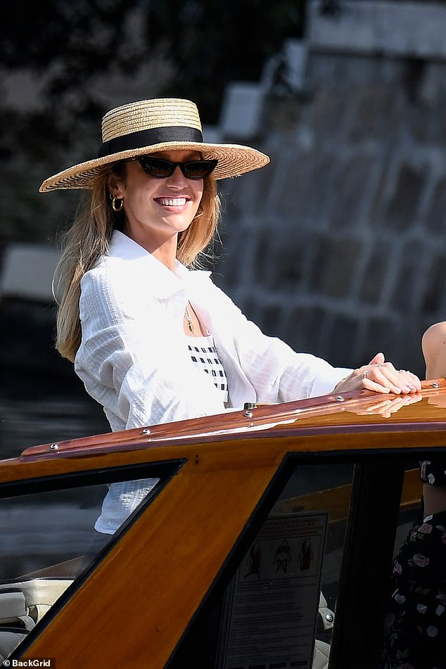 Beaming?: Candice flashed a broad smile as she basked in the sunshine in Italy