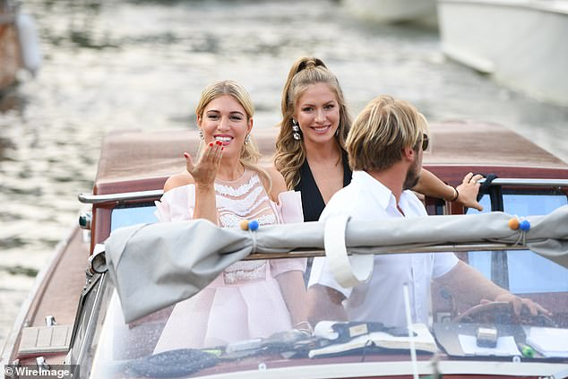 Party: Styling her blonde locks into an updo for the evening, Hofit blew a kiss as she got off the boat and made her way toward the annual festival