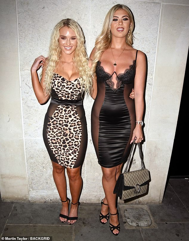 Pals: Lucie posed next to Belle Hassan, 21, who wore an equally as revealing ensemble
