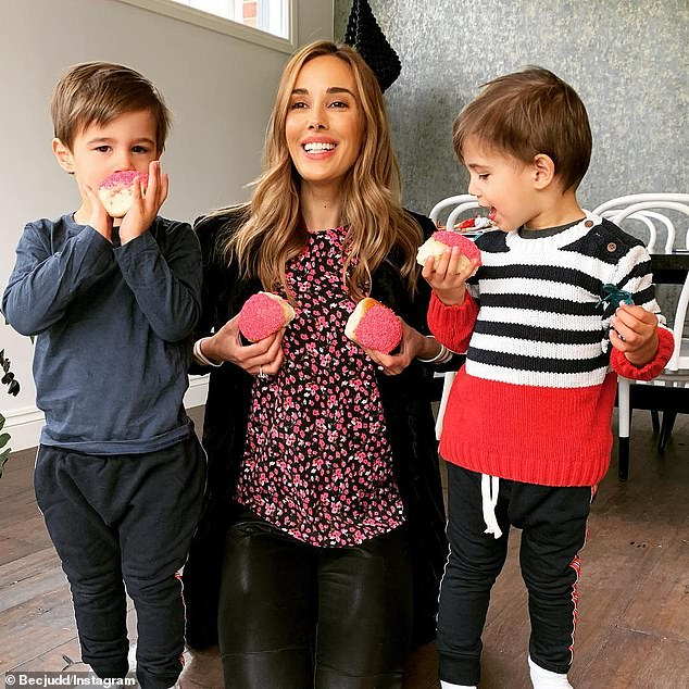 Not fussy! 'They're actually pretty good. They'll give most things a go at least once,' Bec said of her children. Here with two-year-old twins Tom and Darcy