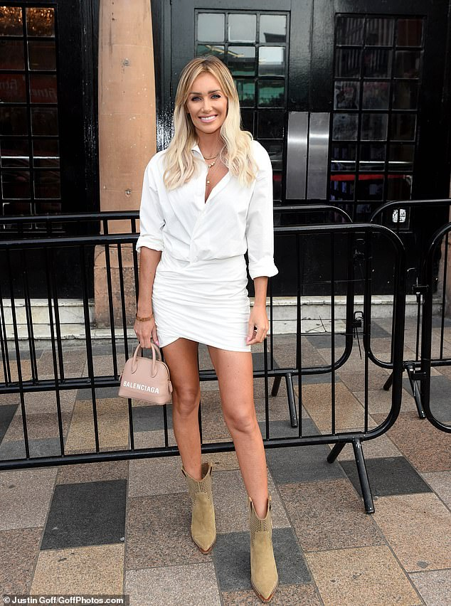 Tremendous pins: Laura Anderson put on a very leggy display in a white shirt minidress and brown cowboy boots