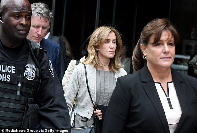 'I am ashamed of the pain I have caused my daughter, my family, my friends, my colleagues and the educational community,' she said in a statement (Pictured outside of federal court in May)