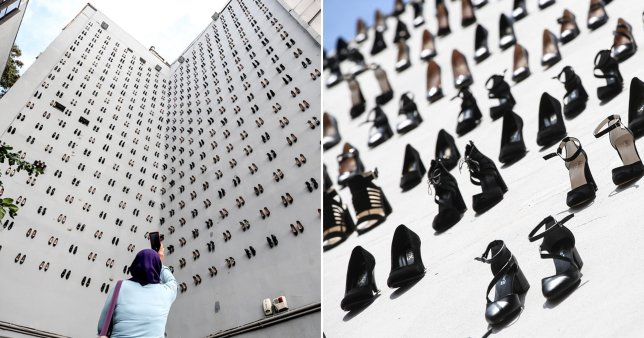Black high heels hanging off an arts building to show the number of women killed in Turkey