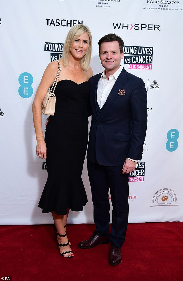 Night out: Declan Donelley and his wife Ali Astall took a break from parenting duties as they attended CLIC Sargent's A Very British Affair auction, at Claridges Hotel in London on Friday
