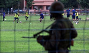 Armed guards watch as Real Kashmir train