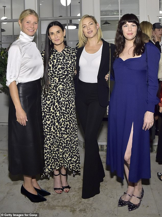 Famous friends: Moore, 56, smiled happily as she posed for photos with Gwyneth Paltrow, Kate Hudson and Liv Tyler at a launch party Monday night for her candid memoir Inside Out