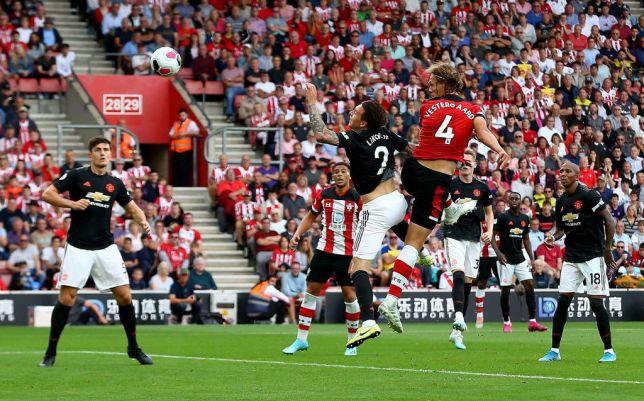 Jannik Vestergaard rises above Victor Lindelof to score for Southampton against Manchester United
